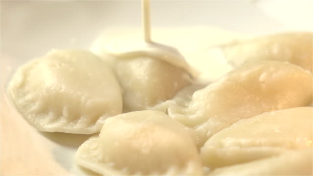 two videos of dumplings in real slow motion - sour cream stock videos & royalty-free footage