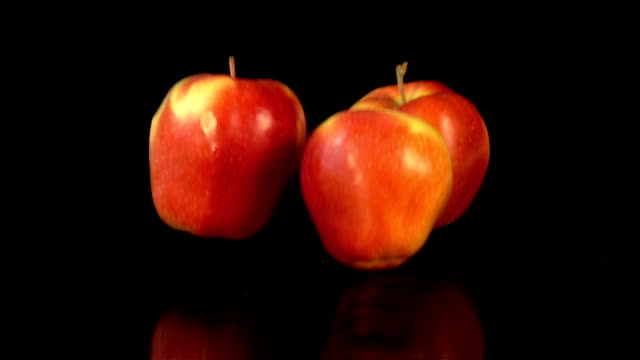two videos of falling apples in real slow motion - three objects stock videos & royalty-free footage