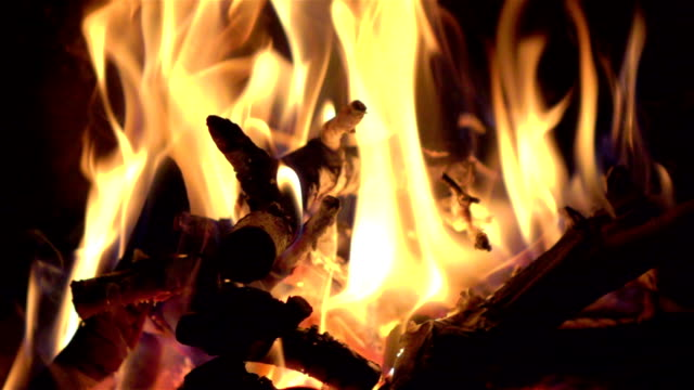 Two videos of fireplace in real slow motion