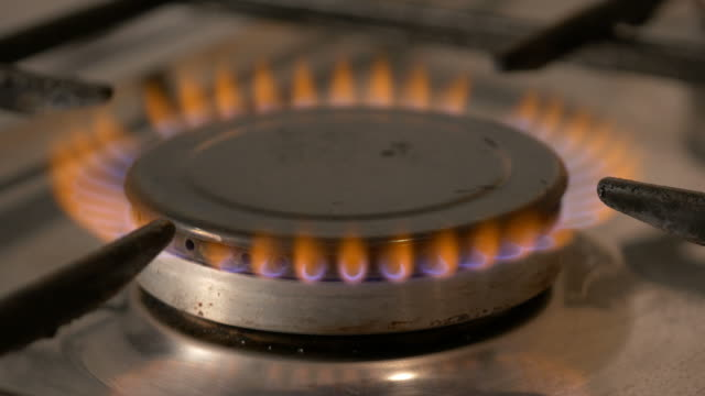 two videos of gas burner in 4k - camping stove stock videos and b-roll footage