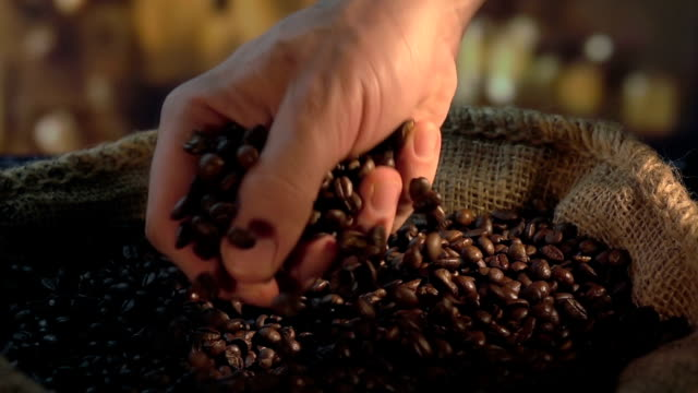 two videos of grabbing coffee beans in real slow motion - drip bag stock videos and b-roll footage