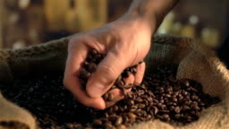Two videos of grabbing coffee beans in real slow motion