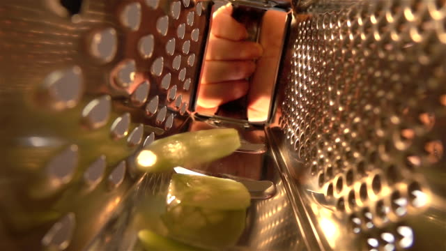two videos of grated cucumber in real slow motion - grater utensil stock videos & royalty-free footage