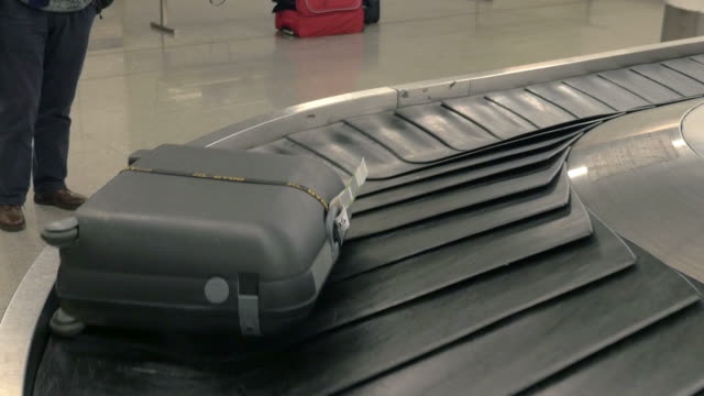 two videos of luggage carousel in 4k - carousel stock videos and b-roll footage