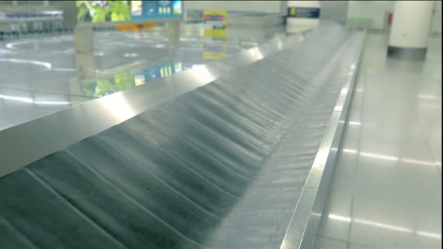 two videos of luggage carousel in 4k - luggage stock videos & royalty-free footage