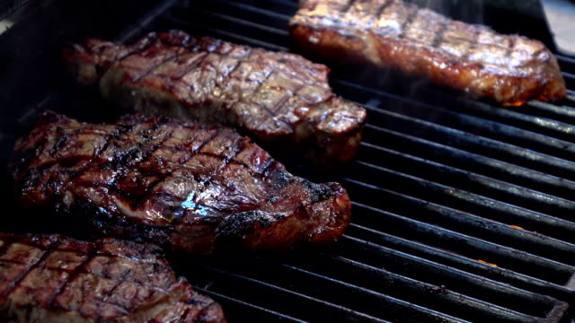 two videos of opening the grill with steaks-real slow motion - barbecue grill stock videos and b-roll footage