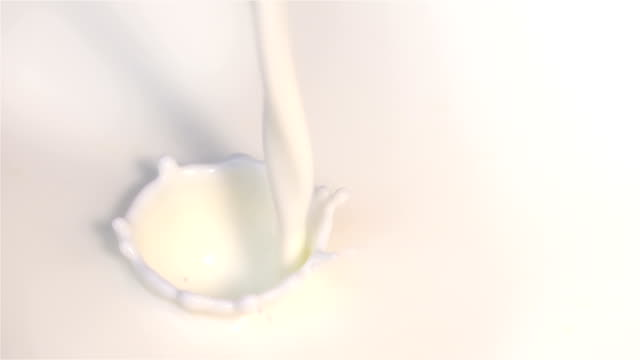 two videos of pouring milk in real slow motion - pouring milk stock videos & royalty-free footage