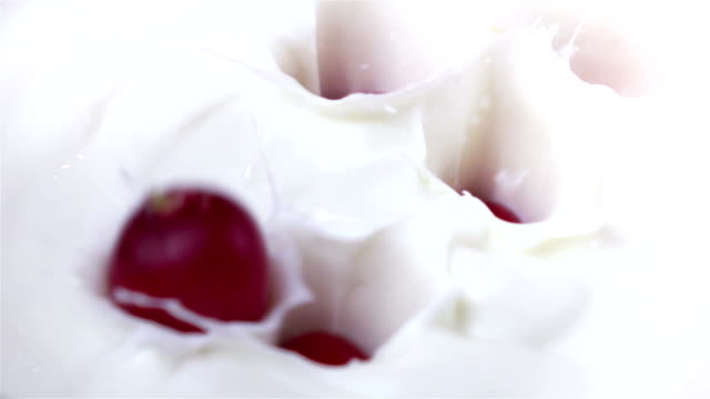 Two videos of radish falling into yogurt in real slow motion