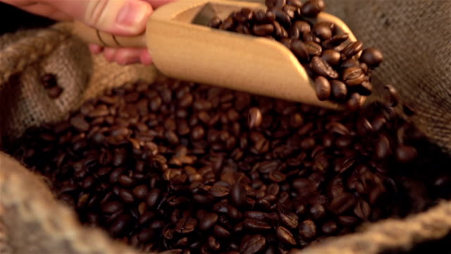 two videos of scooping coffee beans in real slow motion - sack stock videos & royalty-free footage