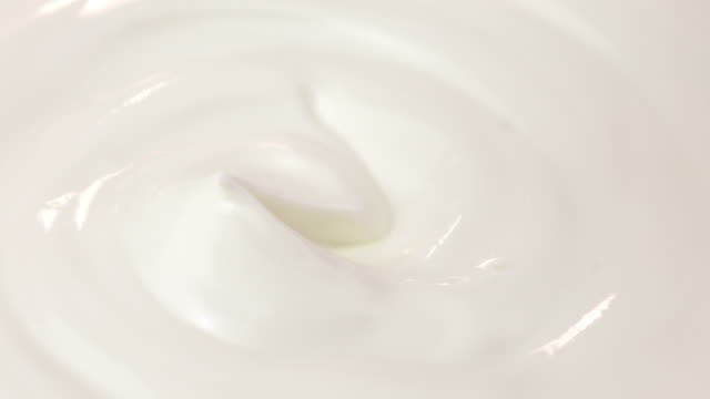 Two videos of scooping yogurt in 4K
