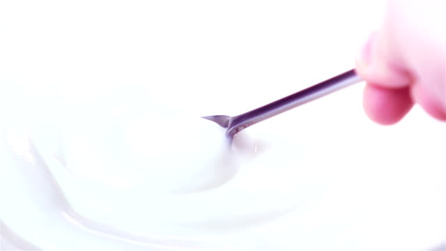 two videos of scooping yogurt in real slow motion - yoghurt stock videos and b-roll footage