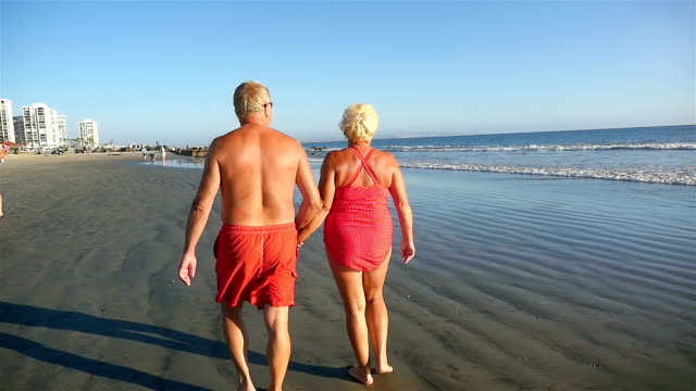 two videos of senior couple in love in slow motion - sunbathing stock videos & royalty-free footage