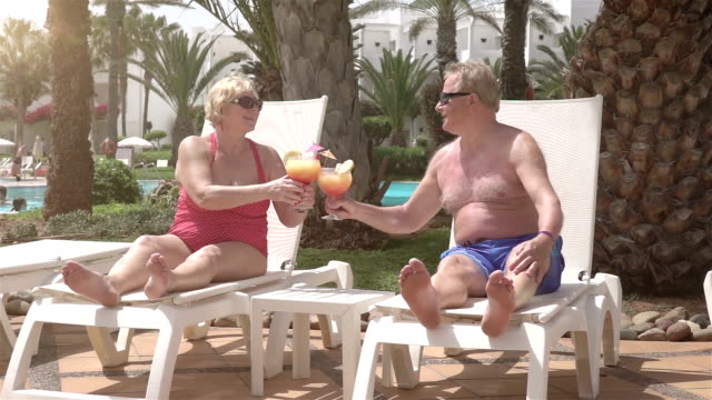 Two videos of senior couple proposing a toast-real slow motion