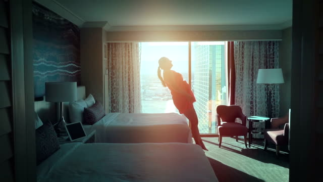 two videos of woman jumping on the bed in real slow motion - escapism stock videos & royalty-free footage