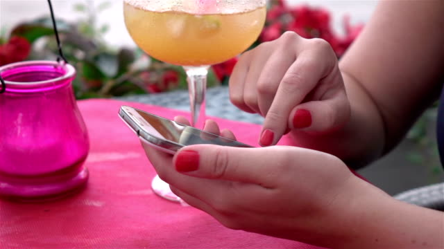 Two videos of woman using cell phone-real slow motion