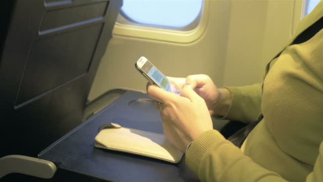 two videos of woman using mobile phone in 4k - pinching stock videos & royalty-free footage