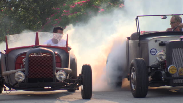 ms, pan, two vintage car drivers burning off tires before driving off, jacksonville, florida, usa - see other clips from this shoot 1403 stock videos and b-roll footage