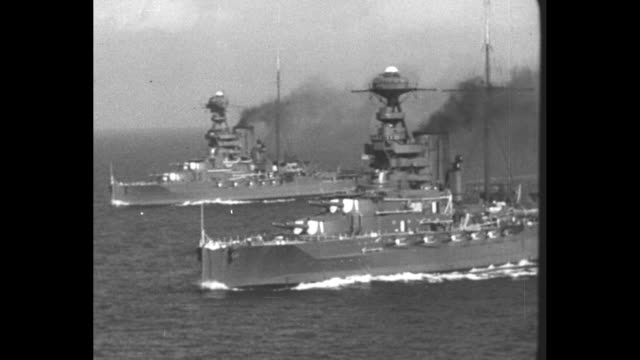 Two warships sail abreast / various shots of warships firing guns / Note [exact month/day not known]
