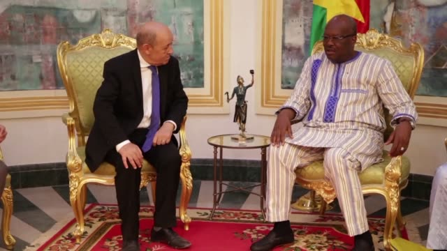 two weeks after attacks in burkina faso which hit targets including the french embassy french foreign minister jean yves le drian met with president... - minister president stock videos and b-roll footage