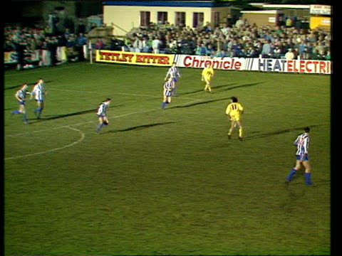 stockvideo's en b-roll-footage met two whitley bay defenders slip over giving warren joyce space to cross for mike flynn who misses absolute sitter from one yard whitley bay vs preston... - whitley bay