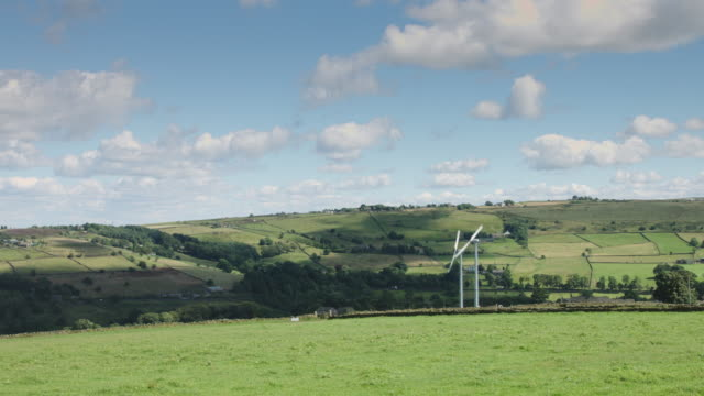 Two Wind Turbines in Rural Landscape