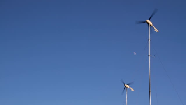 two wind turbines with half moon hd - small stock videos & royalty-free footage