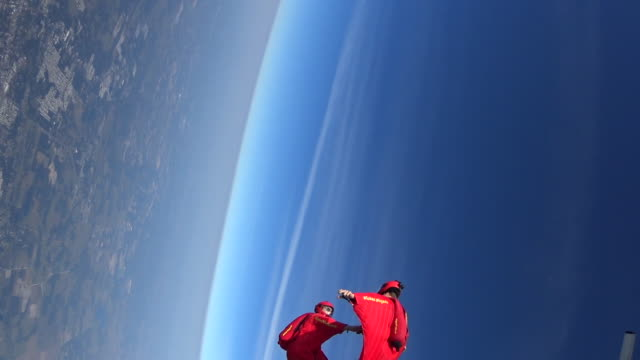 Two wingsuit pilots in free fall performing acrobatics