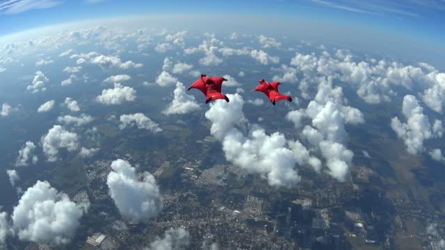 Two wingsuit pilots in free fall performing acrobatics