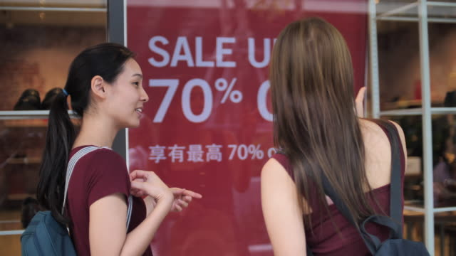 two woman friend shopping in shopping mall - shopaholic stock videos & royalty-free footage