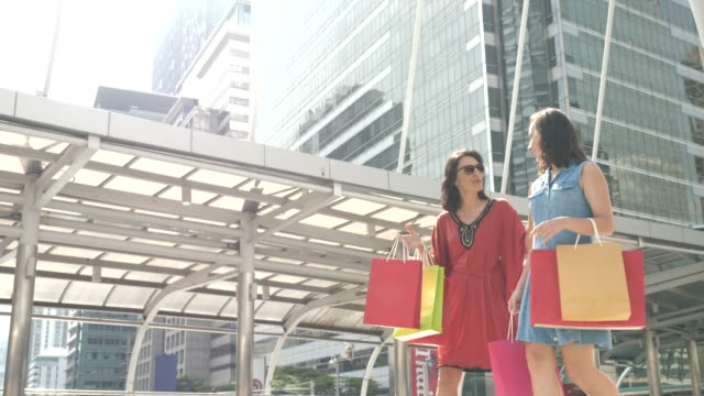 two woman friends shopping walking with shopping bag - voice stock videos & royalty-free footage