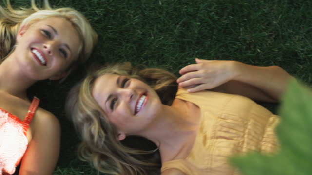 two woman lying on the grass - lawn stock videos & royalty-free footage