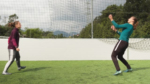 two woman soccer players playing with a soccer ball - skill stock videos & royalty-free footage