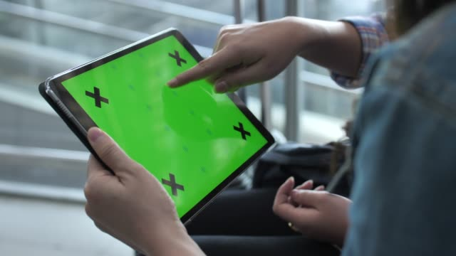 two woman using digital tablet green screen - horizontal stock videos & royalty-free footage
