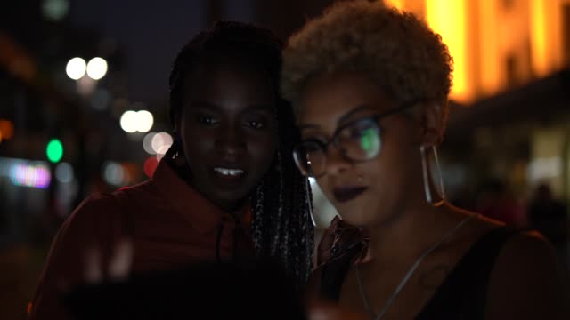 two woman using tablet at night - pardo brazilian stock videos & royalty-free footage