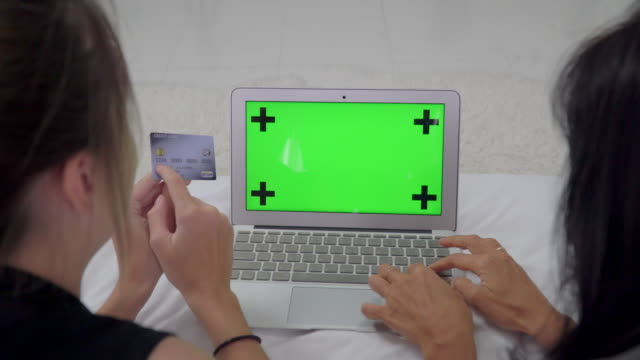 Two Woman  using Tablet Computer with green screen