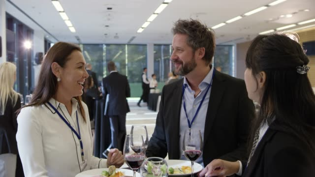 two women and a man eating a meal during a lunch break in the conference center - seminar stock videos & royalty-free footage