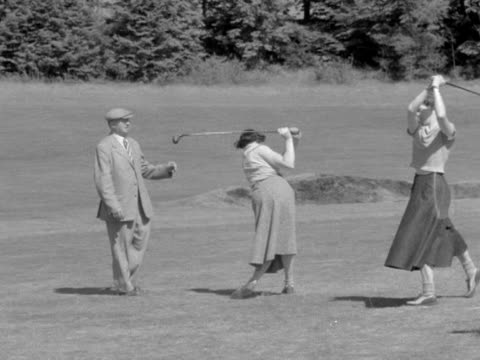 two women are given a golfing lesson at the bisham national recreation centre - golf swing stock videos & royalty-free footage