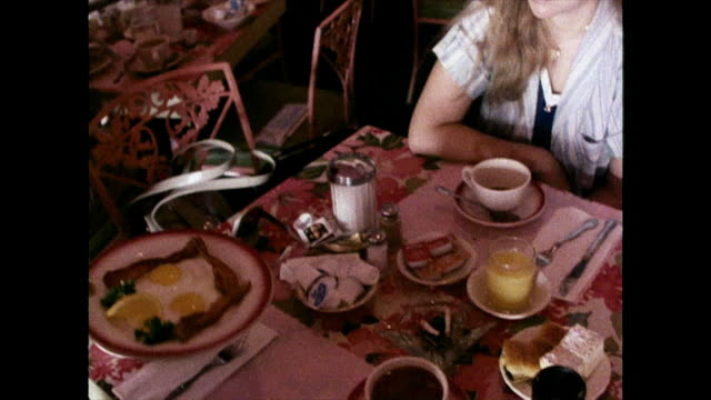 two women are served fried breakfast in 1980 - breakfast stock videos & royalty-free footage