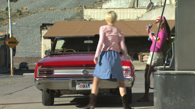 two women at a gas station - see other clips from this shoot 1138 stock videos and b-roll footage