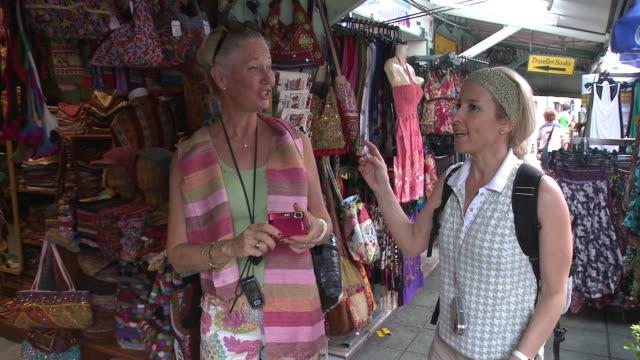 MS Two women at street market, Bangkok, Thailand