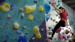 Two Women Bouldering at Climbing Gym