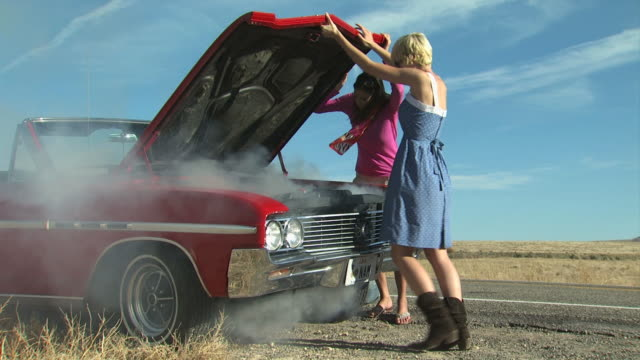 two women broken down on the side of the road - see other clips from this shoot 1138 stock videos and b-roll footage