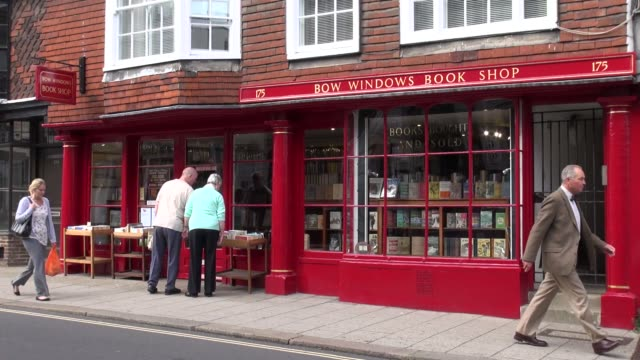 two women browsing outside a colourfull bookshop in lewes the picturesque country town of east sussex england - east sussex stock videos & royalty-free footage