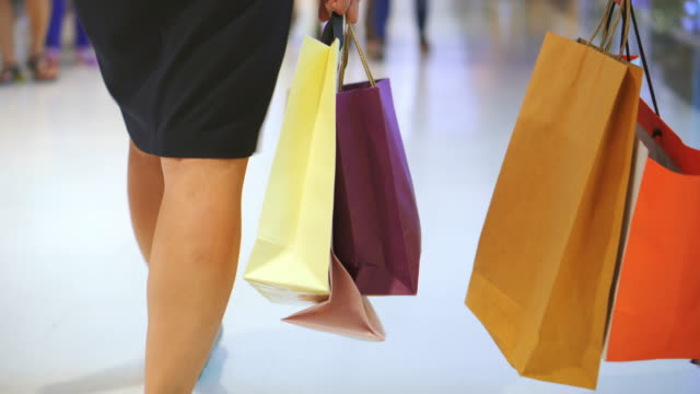 Two Women Carrying Shopping Bag In The Mall