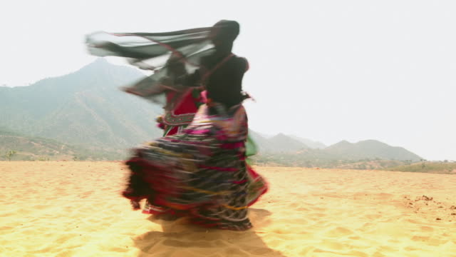 Two women dancing in the desert, Rajasthan, India