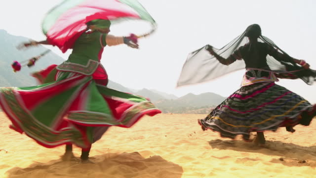 two women dancing in the desert, rajasthan, india - traditional ceremony stock videos & royalty-free footage