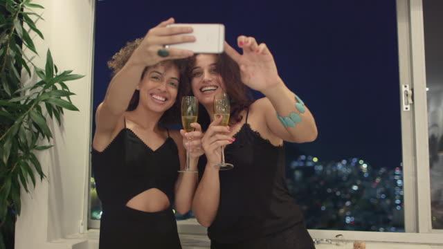 MS Two women drink champagne and take a selfie / Rio de Janeiro, Brazil