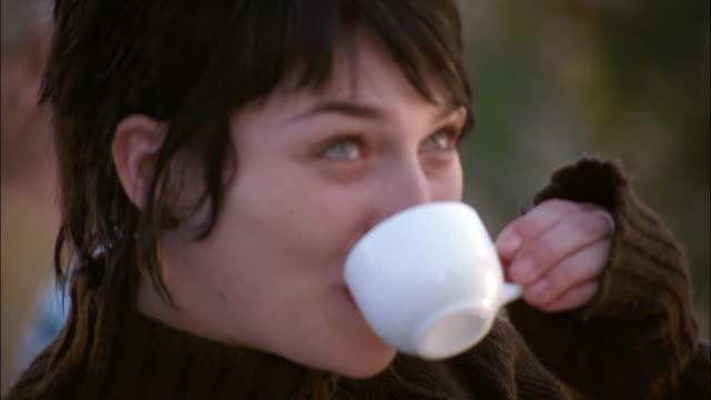 two women drink coffee al fresco in romania. - coffee drink stock videos & royalty-free footage