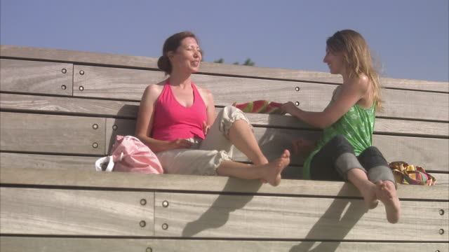 Two women eating watermelon Sweden.