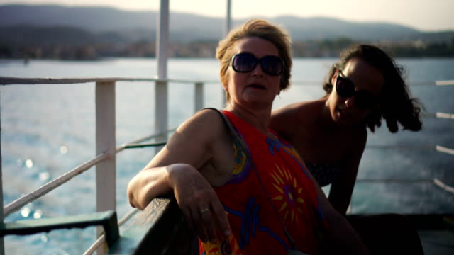 Two women enjoying the ride on ferry boat